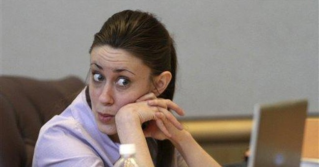 Casey Anthony fights tears as judge reads charges