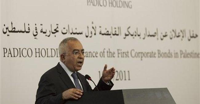 Palestinians' Fayyad could keep PM job