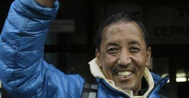 Nepal Sherpa climbs Everest for record 21st time