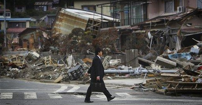 Worker at Japan's tsunami-hit nuclear plant dies