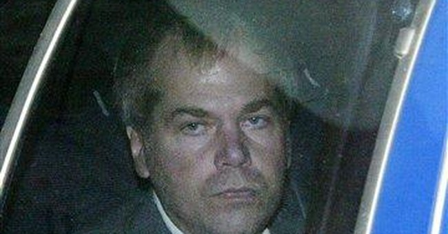 Judge OKs extra releases for Ronald Reagan shooter