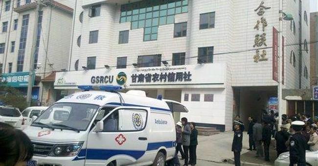 Gasoline bomb explodes in China bank, hurts dozens