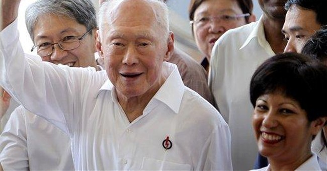 Singapore founding father Lee quits Cabinet post
