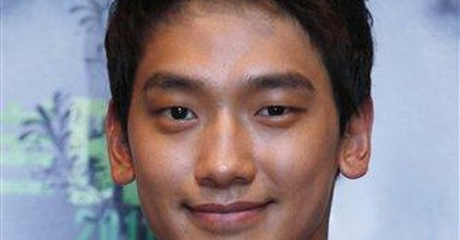 Rain talks music and movies, but not military duty