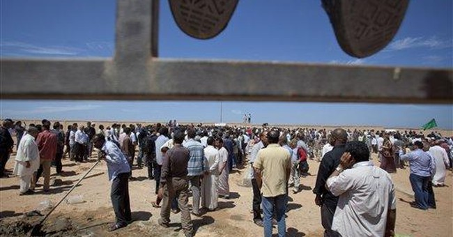 Libyans bury 9 men reportedly slain in NATO strike