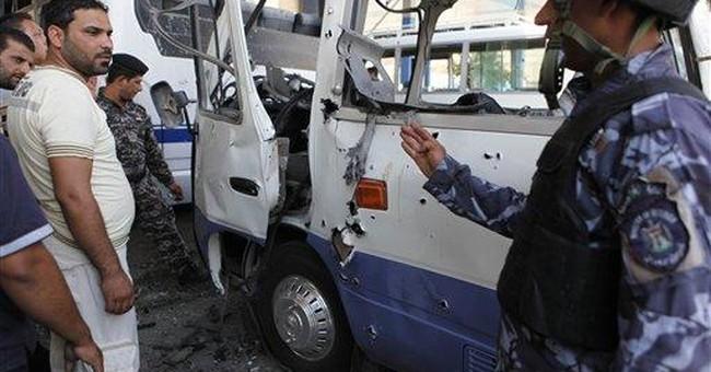 Triple bombing kills 27 at Iraqi police station