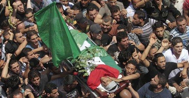 Palestinian refugees in Lebanon, Syria bury dead