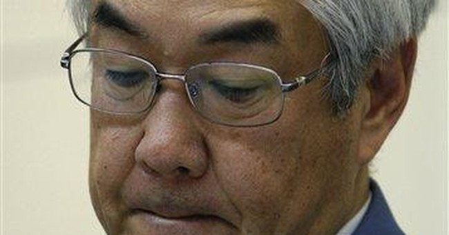 Japan sticks with timetable to resolve nuke crisis