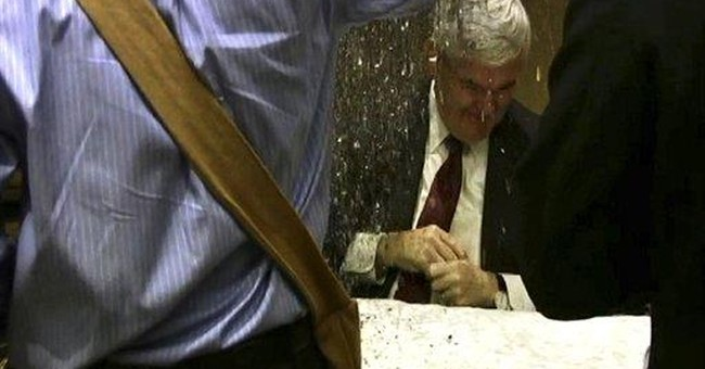 Gingrich hit with glitter at Minneapolis event