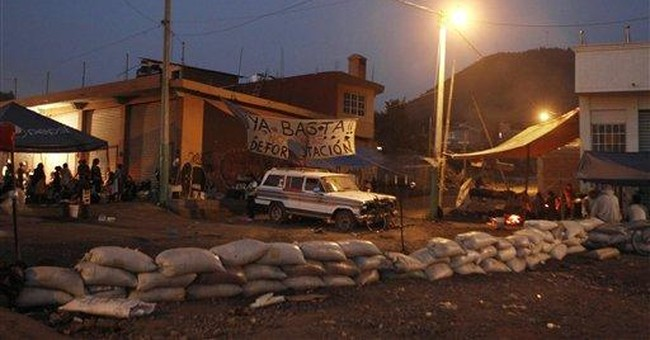 Mexico town stands up to drug gangs with barricade