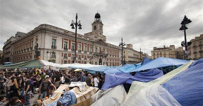 Spaniards defy ban to demonstrate in Madrid