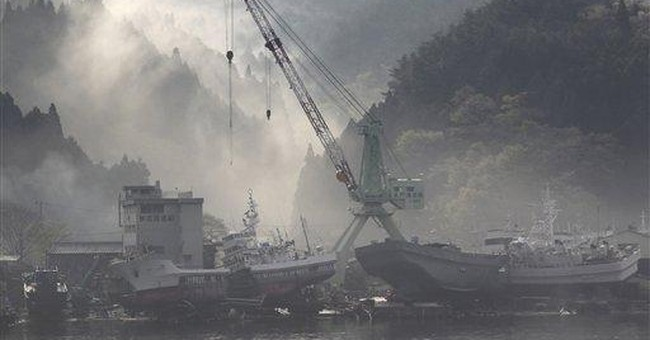 Disasters send Japanese economy into recession