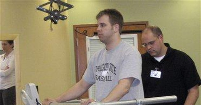 Paralyzed man freely moves after getting implant