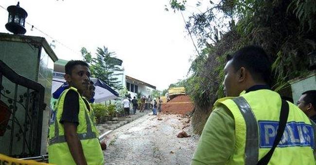 Landslide buries 20 boys at Malaysian orphanage
