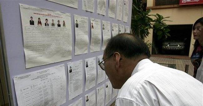 Vietnamese voters cast ballots for parliament