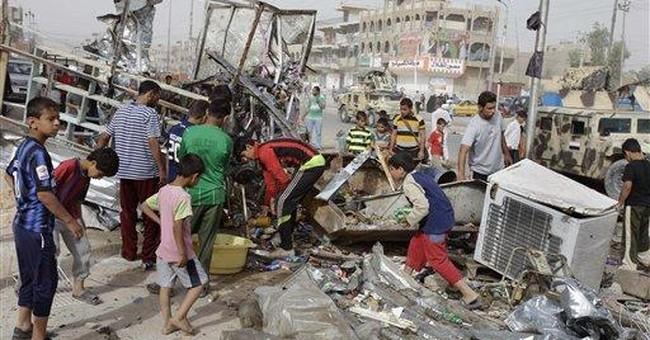 Iraqi security targeted as bombs kill 16 people