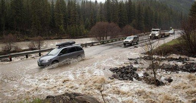 Officials contend with rising rivers in Mont.