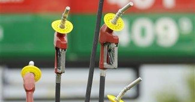 Oil rises near $100, while pump prices fall again