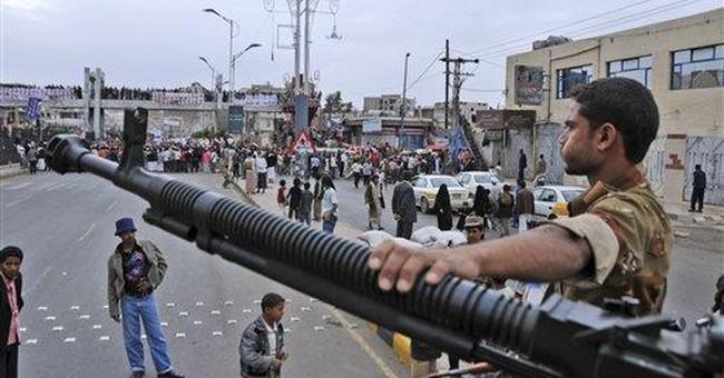 Yemen's president vows no retreat as battles rage