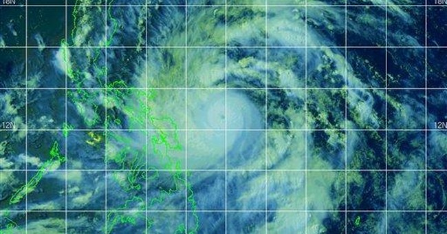 Thousands evacuate as typhoon skirts Philippines