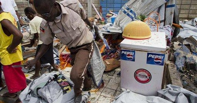 Haiti PM softens stance on Clinton quake panel