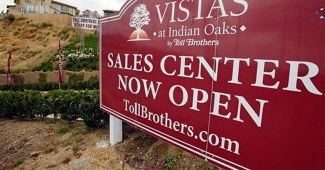 Toll Brothers posts smaller loss in fiscal 2nd-qtr