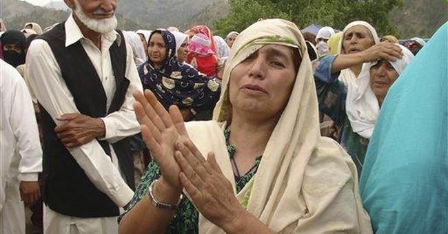 Suicide truck bomb kills at least 32 in Pakistan