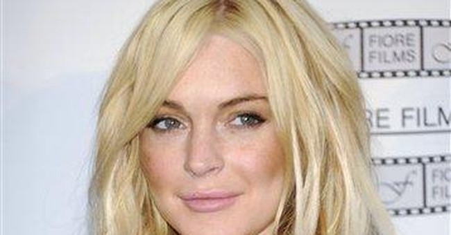 Lohan begins serving sentence on house arrest