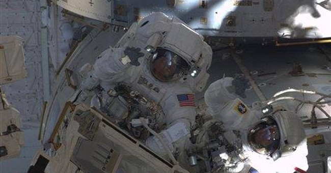Astronaut eager for 1st look at wife from orbit