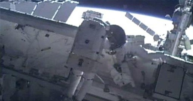 Last shuttle spacewalkers make history above Earth