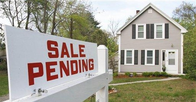 Contracts to buy homes fall to a 7-month low