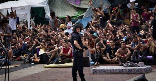 Spanish police clash with protesters, many hurt
