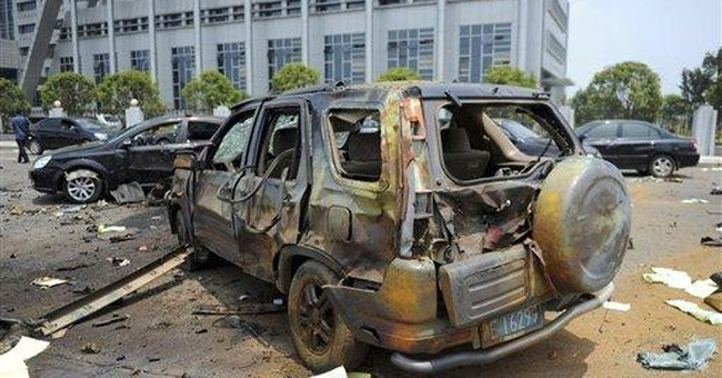Blast at bus company kills 1 in central China