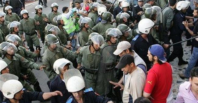 Morocco police violently disperse protests