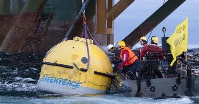 Greenpeace activists climb Greenland oil rig