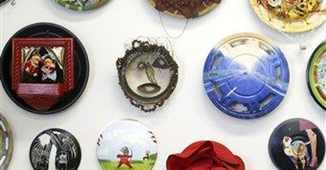 Hubcaps as canvas: Artists turn junk into jewels