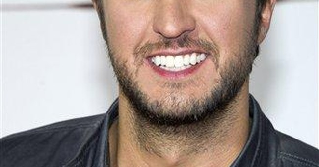 Luke Bryan learns from top acts for headlining gig