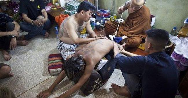 Thailand seeks to ban tourists' Buddha tattoos