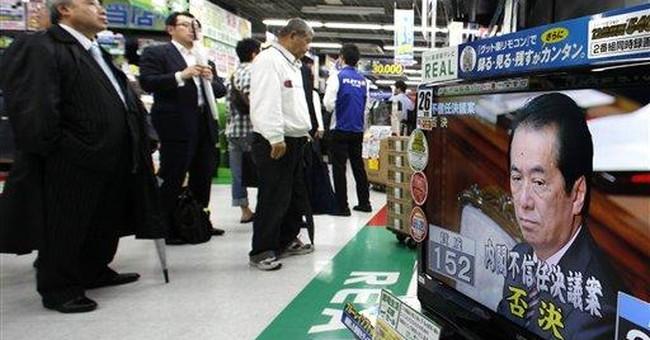 Japan's PM beats censure, hints at resignation