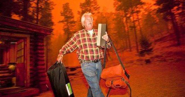 Ariz. fire burns summer cabins, forces evacuations