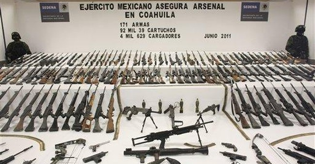 Mexico seizes 154 rifles from buried cartel cache