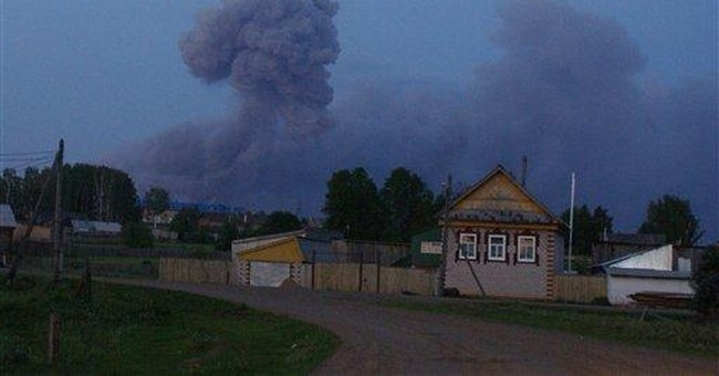 Russia says arsenal fire extinguished