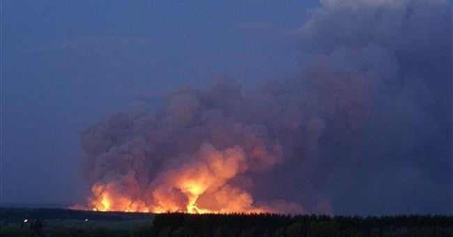 Arsenal fire, blasts shake Russian region
