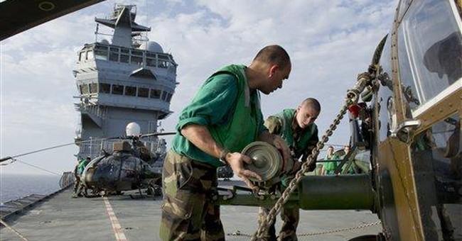 NATO jets target Libyan military barracks