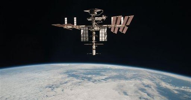 Unique shots of space station and shuttle released