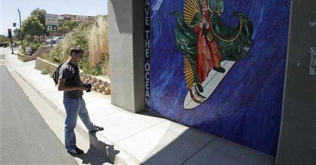 Surfing Madonna mosaic draws mass following
