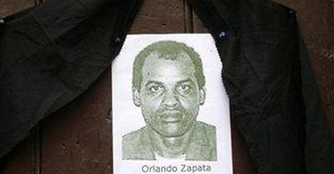 Cuba dissident's remains exhumed, family to leave