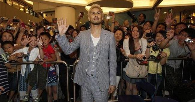 Hirai mourns Japan quake at Hong Kong performance