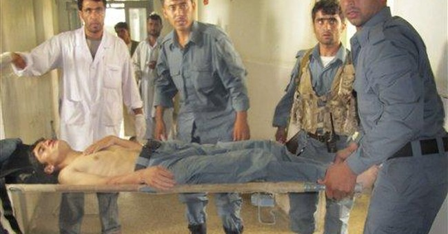 Suicide bomber kills 4 police in north Afghanistan