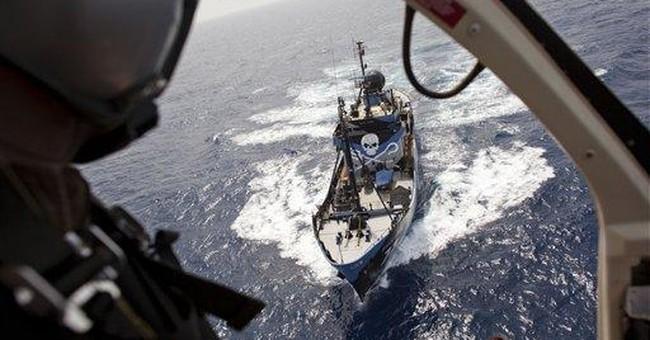 Environmentalists, tuna fishers battle at sea